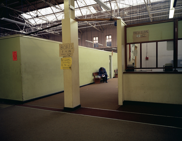 , 'Man filling in Form, Dole Office, Liverpool, from the series Beyond Caring,' 1984, Anthony Reynolds Gallery
