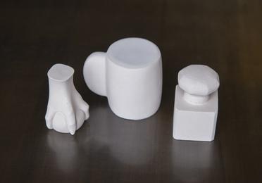 Three Paperweights (Mug, Knob, Claw)