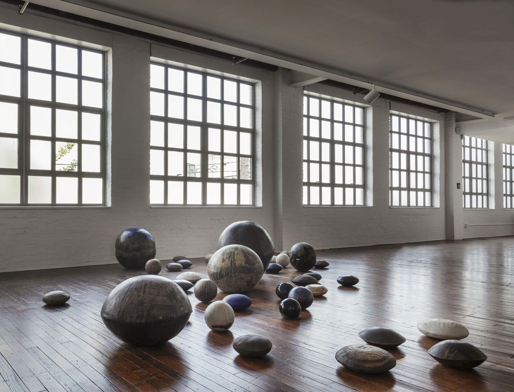 "Toshiko Takaezu, ""Dry Riverbed"", c. 1980. 41 ""River Rocks"" and ""Moons:"" ceramic, glazes; variable. The Takaezu Studio, Quakertown, NJ; Courtesy Jeffrey Spahn Gallery Incorporating works from the collection of Peter D. Russo © The Noguchi Museum. Photo: Elizabeth Felicella"