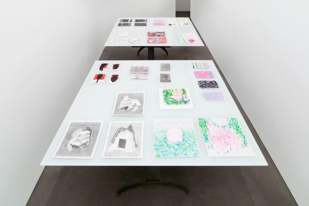 Works on paper presented on two glass tables in the small PROTO GOMEZ gallery space.