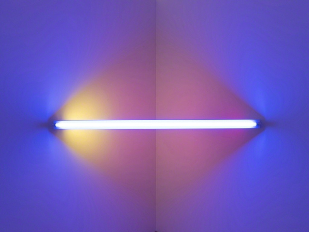 Dan Flavin, untitled (to Virginia Dwan) 1, 1971. Blue, red, pink, and yellow fluorescent light. 8 ft. wide across a corner. Installation view:Dan Flavin: cornered fluorescent light, Mana Contemporary, Jersey City, 2018. Photo: John Berens. Courtesy of the Estate of Dan Flavin
