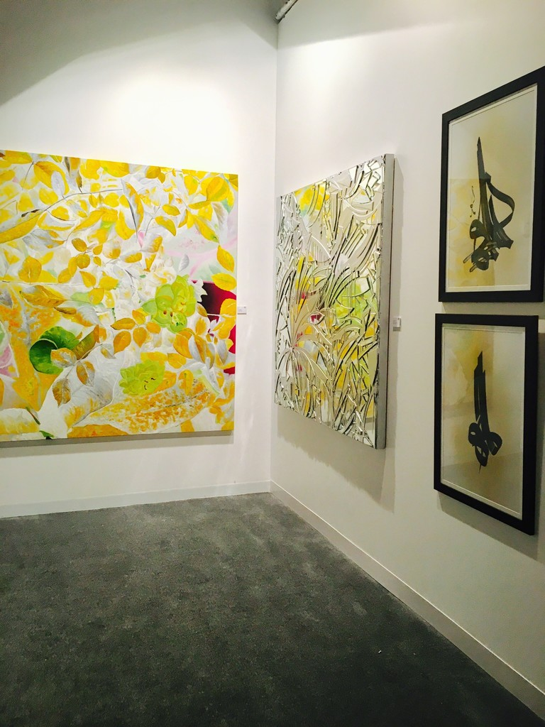 Omar Zeiden's gorgeous yellow flowers beside Mirros by Connie Noyes, and Al Fail's Calligraphy.