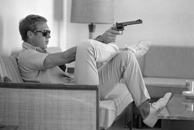 , 'Steve McQueen aims a pistol in his living room, California,' 1963, Atlas Gallery