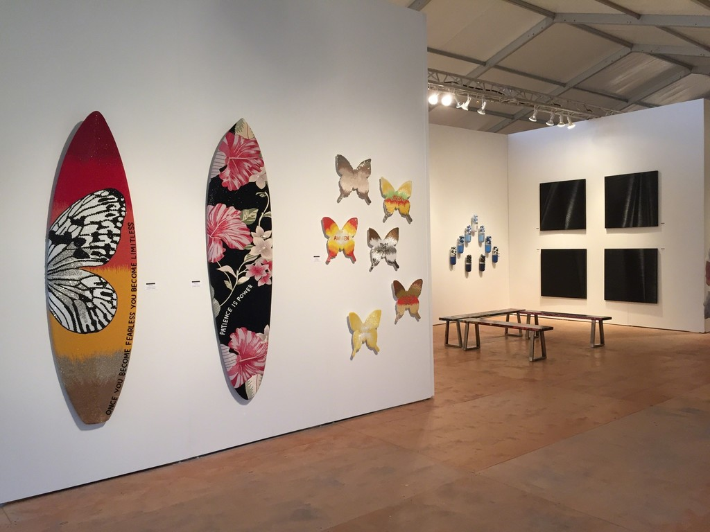 "(from left) Stephanie Hirsch beaded surfboards and butterflies, (center) Edie Nadelhaft ""Blue Angels"" and (right) paintings by James Austin Murray"
