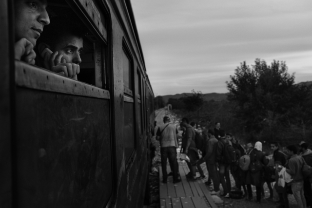 , 'Refugees prepare to board a train at Gevgelija,' 2015, Monroe Gallery of Photography