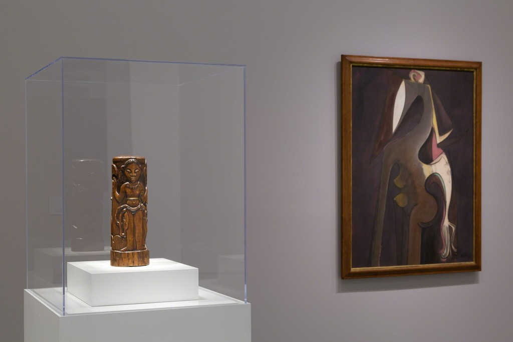Installation view of Masterworks from the Hirshhorn Collection at the Hirshhorn Museum and Sculpture Garden, 2016. Left to right: Paul Gauguin, Hina with Two Attendants, 1892; Wifredo Lam, Siren of the Niger, 1950. Photo: Cathy Carver