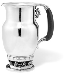 Sterling silver pitcher with grapes. Handle of carved ebony.