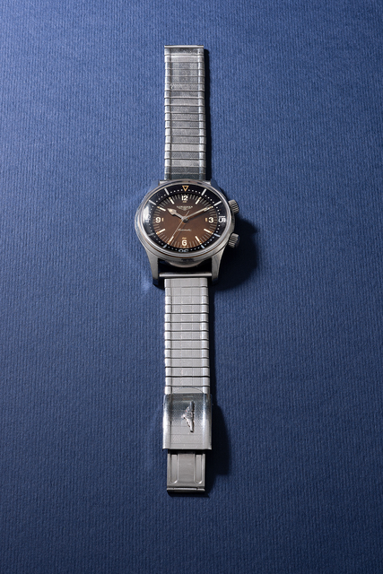 Longines, 'A rare and attractive stainless steel diver's wristwatch with bracelet, sweep center second, inner rotating bezel and tropical dial', 1966, Phillips