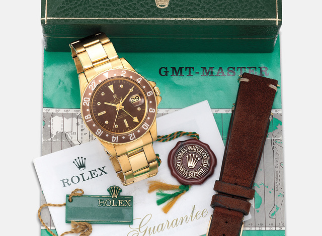 """Rolex, 'A fine and very rare yellow gold dual time wristwatch with center seconds, date, straight hands, engraved back, """"nipple"""" dial, bracelet, guarantee and box', Circa 1968, Phillips"""