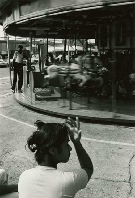 Louis Draper, 'Woman and Carousel, Coney Island', 1976, Bruce Silverstein Gallery
