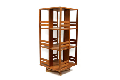 A late 20th century teak revolving bookcase