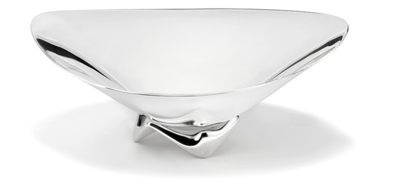 A large sculptural sterling silver bowl on openwork three-sided foot.