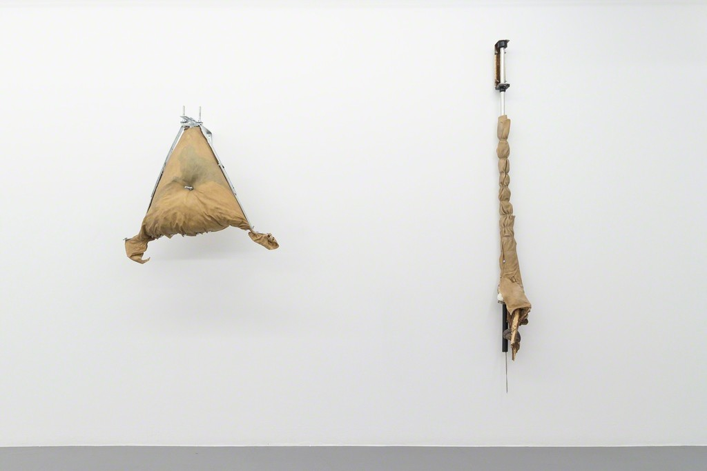 Piercad, Parchment of cow skin, (residual product in the production of leather), metal objects, textiles and wood, 85x85x45 cm.  Knippe, Parchment of cow skin, (residual product in the production of leather), metal objects, textiles and wood, 210x15x20 cm