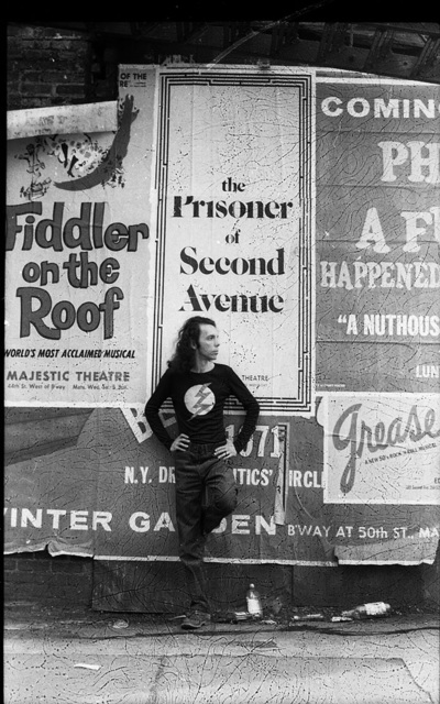 , 'Hélio Oiticica in front of a poster for Neil Simon's play The Prisoner of Second Avenue, in Midtown Manhattan,' 1972, Whitney Museum of American Art