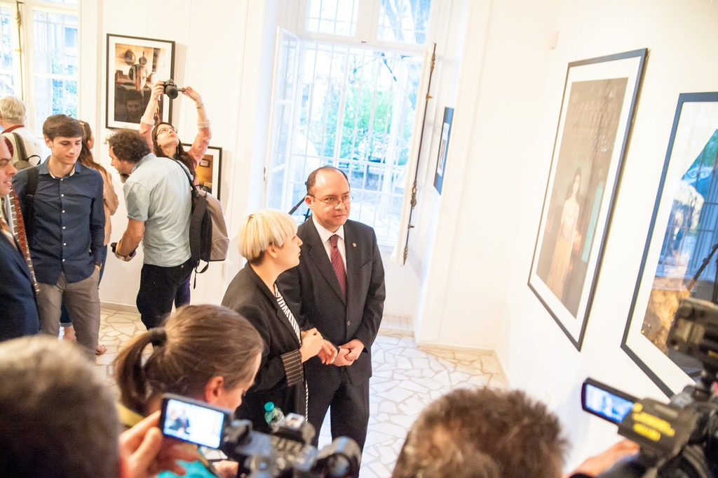 Opening night: The Atlas of Beauty World Premiere. Artist Mihaela Noroc and Romanian Minister of Foreign Affairs, Bogdan Aurescu. April 16, 2015, Artfooly Gallery, Bucharest, Romania.