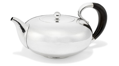 Hammered sterling silver teapot. Handle of carved ebony.