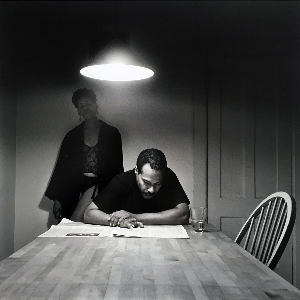 Carrie Mae Weems Untitled Man Reading Newspaper Kitchen Table