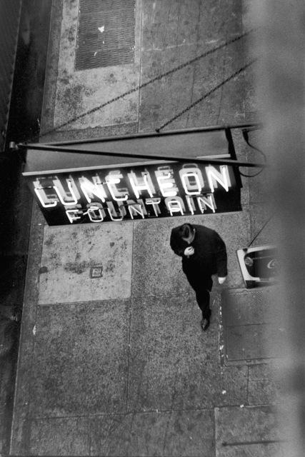 , 'Man Walking Under Neon Sign, West 22nd Street, NYC,' 1958, Robert Mann Gallery