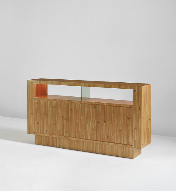 Jean Royère, 'Étoile double-sided illuminated bar, from the Parachini residence, France', 1958, Design/Decorative Art, Straw marquetry-covered wood, glass, brass, Phillips