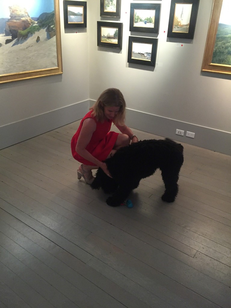 Laura Grenning with Cooper the Portuguese Water Dog at the Opening Reception of Marc Dalessio: Rediscovers Italy.