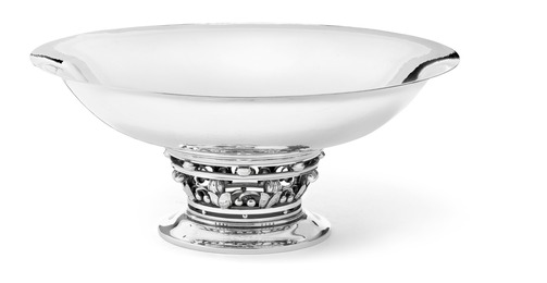 A circular sterling silver tazza with openwork stem of foliage and berries.
