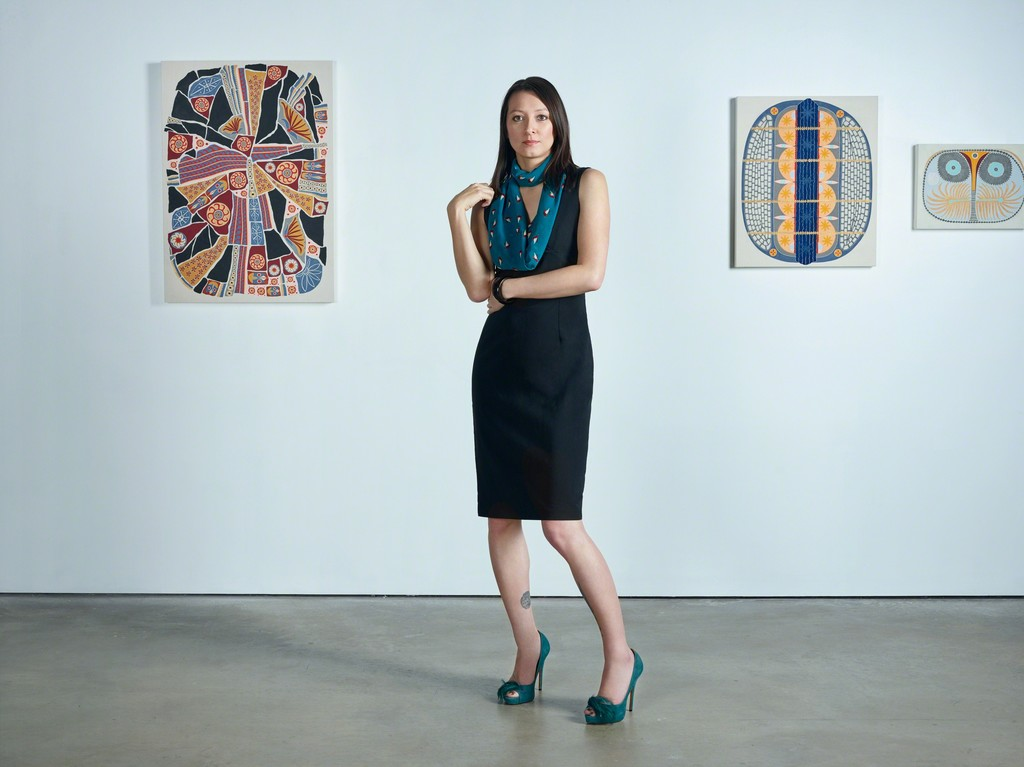 Cindy Lisica in her gallery with artwork by Catherine Colangelo. Photo by Jan Rattia.
