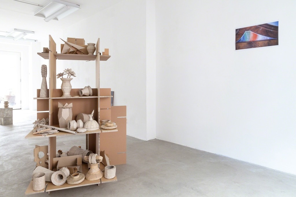 "exhibition view Selma Weber: (left) ""Collection"", 2018, cardboard-pottery on shelf, 170 x 116 cm and (right) ""Ciel"", 2018, injet print 