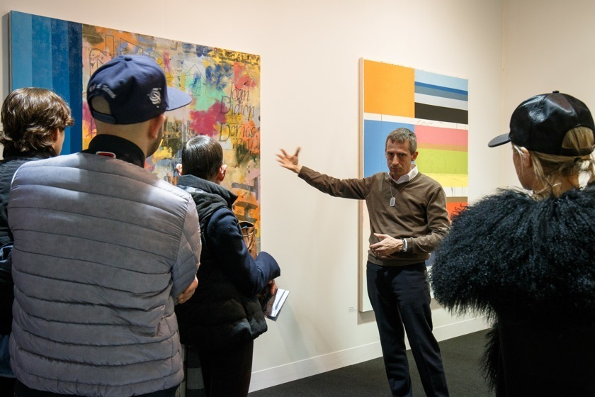 Gallery owner Theo Downes-Le Guin discussing Jack Featherly's work during a tour at VOLTA NY. Image courtesy David Willems Photography.