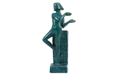 An Art Deco stoneware figure of an Egyptian dancer