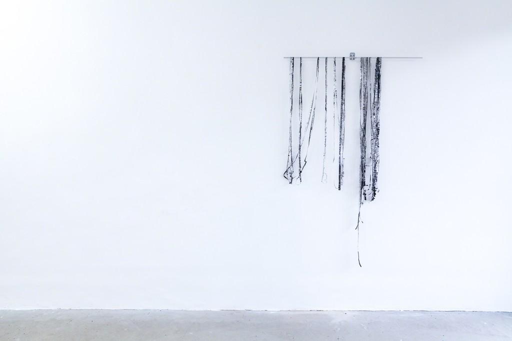 "Jens Standke, exhibition view: ""Transparent Tape Machine"", 2016, detail   d.i.y.-audio band machine for transparent tape: laser, electronics, motor, aluminium, acrylic glas   image: ©dasesszimmer"