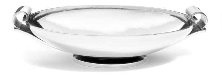 A sterling silver fruit dish with hammered surface and two curved handles.