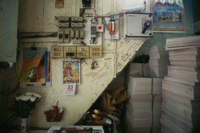 , '11_Still life with telephone numbers, moving poster and stacks of unfolded cement knife boxes,' 2011, Art Vietnam Gallery