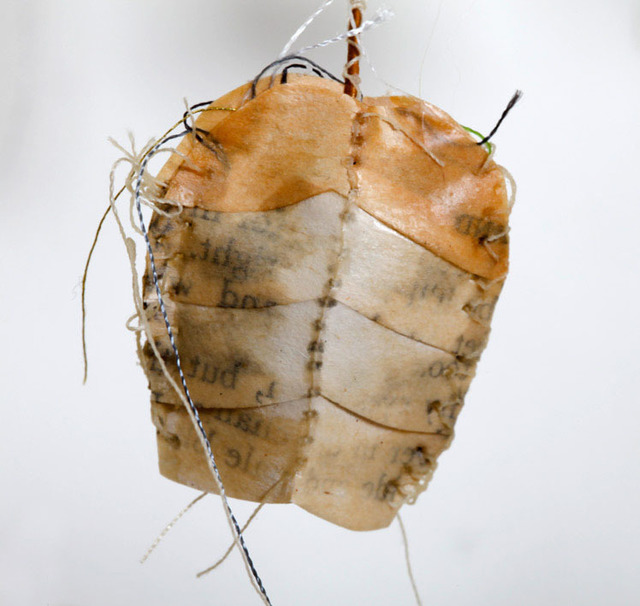 Lisa Kokin, 'Rattlesnake Band-it', 2013, Mixed Media, Cowboy book pages, thread, beeswax, wire, mull, cotton batting, Seager Gray Gallery