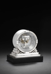 Sterling silver barometer with hammered surface and stylized ornamentation. Munted on a black stone base.