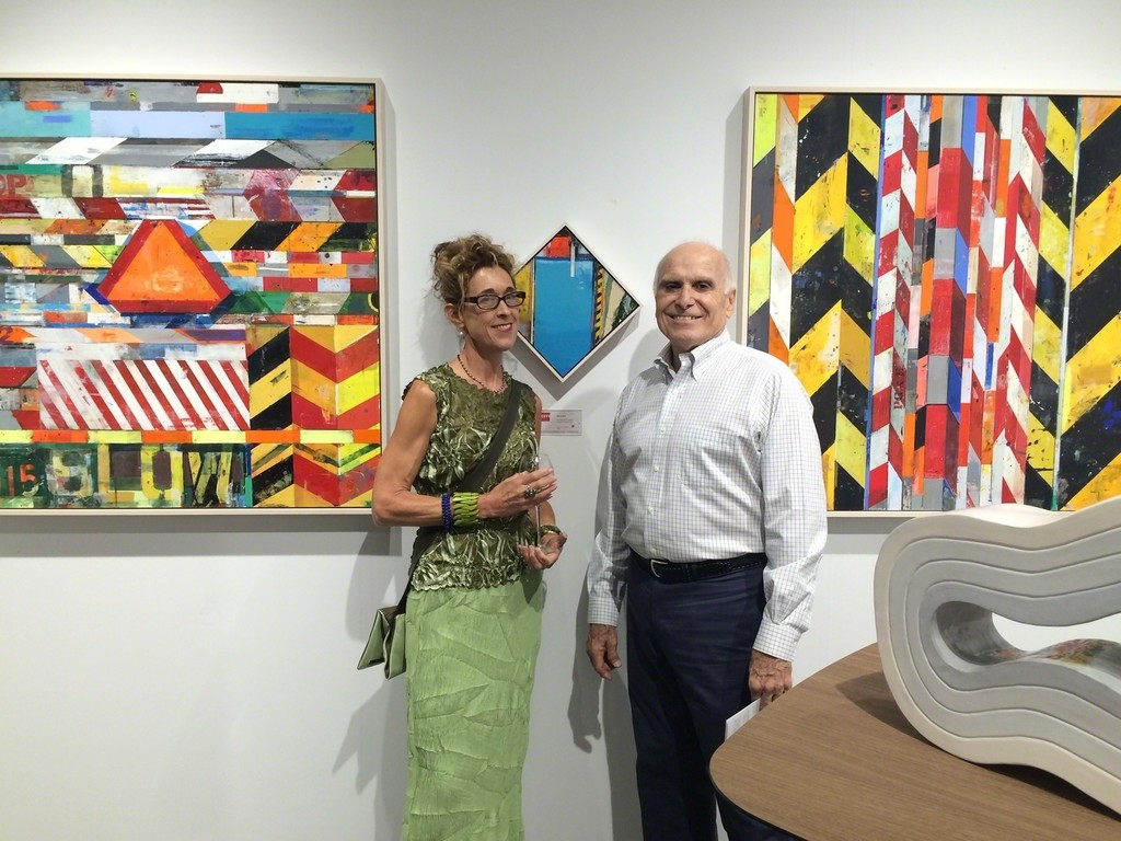 Artist Kim Frohsin with collector at Andra Norris Gallery's Art Silicon Valley International Art Fair booth in 2015