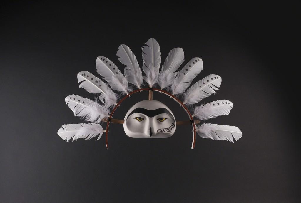 """Snow (Ig'it)"" by Allie High (Aleut/Haida/Ts'msyen) Basswood, Steambent Oak, Acrylic, Turkey Feathers 15""h x 23""w x 4""d"