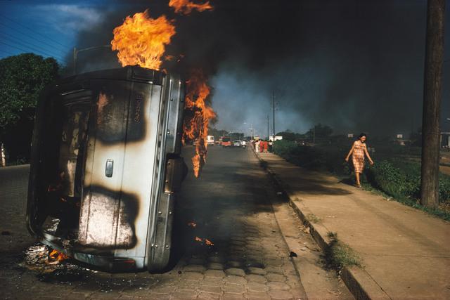 , 'NICARAGUA. Managua. Car of a Somoza informer burning in Managua.,' 1978-1979, Magnum Photos