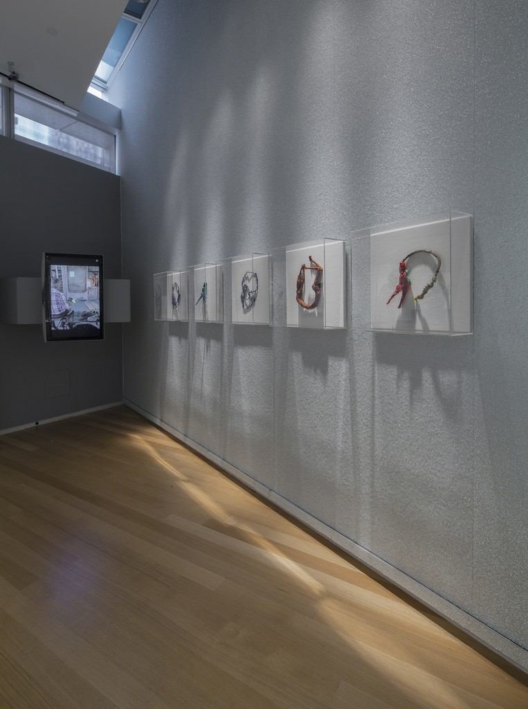 Installation photo of 'Maryland to Murano: Neckpieces and Sculptures by Joyce J. Scott' at the Museum of Arts and Design. 2014.
