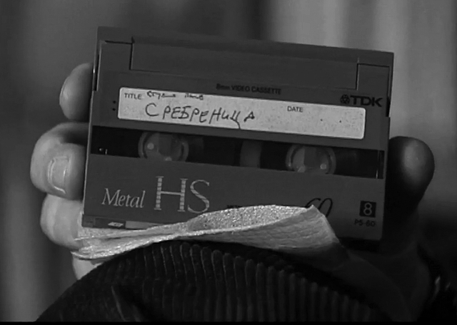 , 'Before the Fall there was no Fall (Serbian journalist Zoran Petrović holding a tape shot in Srebrenica, research material),' 2014, SMBA