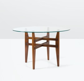 a table with a wooden structure and glass top
