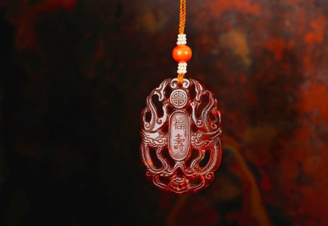 , 'An amber abstinence or zhaijie pendant,' China: Qianlong (1736-95), Rasti Chinese Art