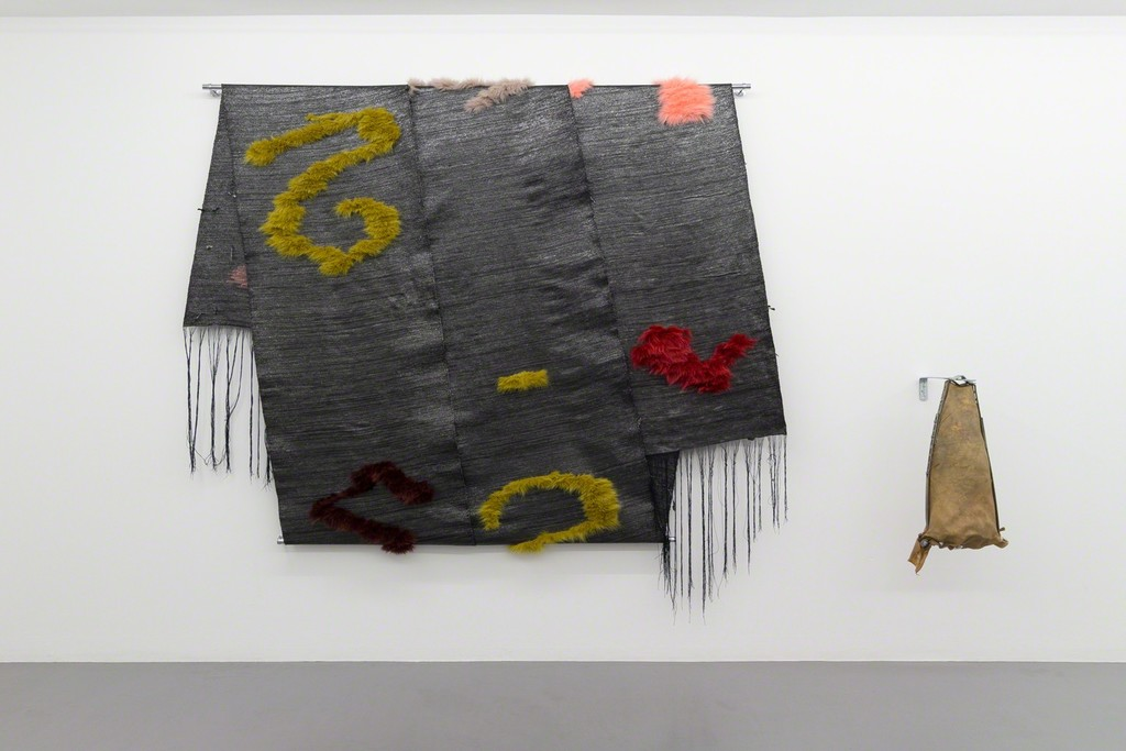 Tysk våg III, Weave of VHS tapes from deutsche welle film archive, fur, metal, 190x230x10 cm