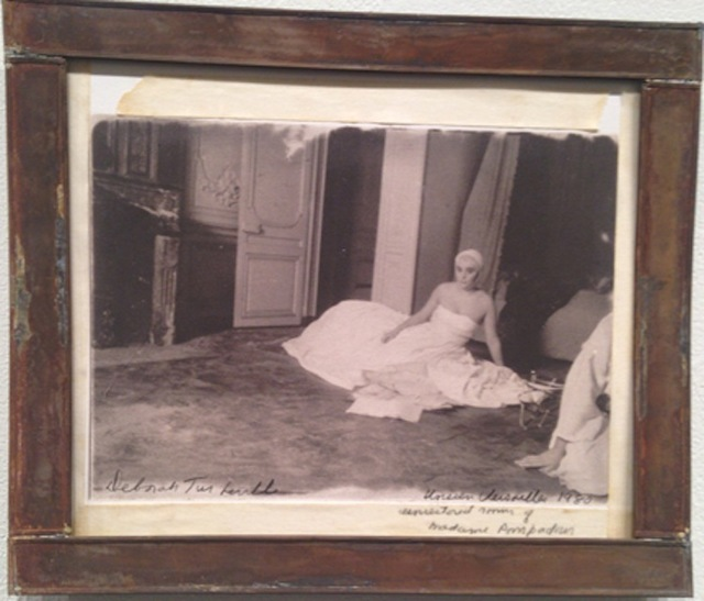 ", 'Woman seated in the unrestored bedroom of Madame Pompadour, from ""Unseen Versailles"",' 1980, Staley-Wise Gallery"