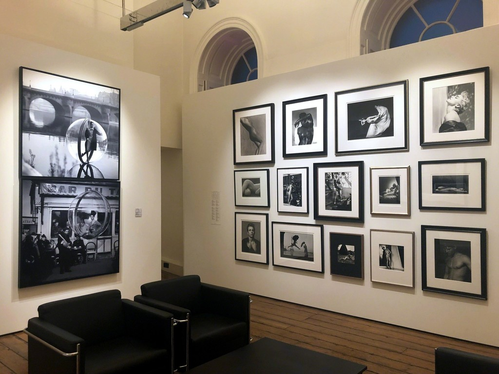 "Melvin Sokolsky's ""On the Seine II, Paris"" and ""Bar du Baguette, Paris"" - Salon style wall including work by Barbara Morgan, Helmut Newton, Herb Ritts, Roy Schatt and Ruth Bernhard - Photo London 2019"