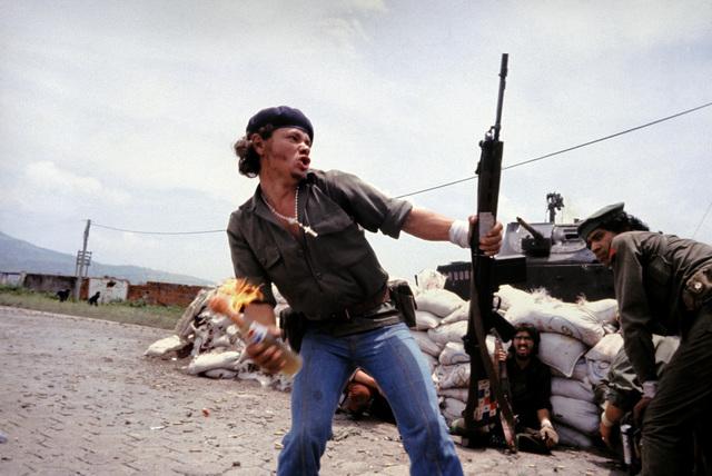 , 'Sandinistas at the walls of the Esteli National Guard headquarters.,' 1979, Magnum Photos