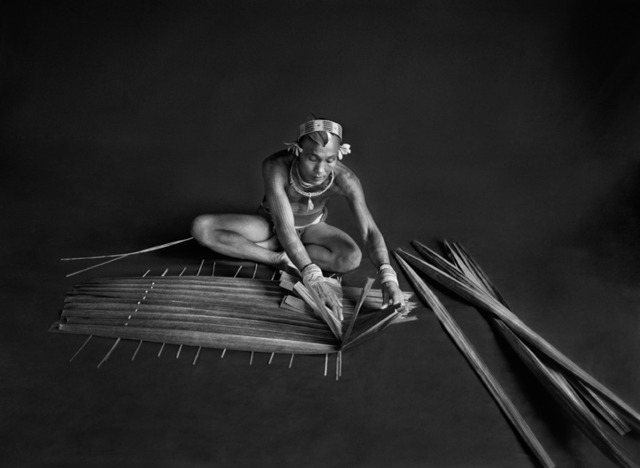 , 'Teureum, sikeirei (shaman), leader of the Mentawai clan, prepasring a filter for sago. Siberut Islansd.,' 2008, Sundaram Tagore Gallery