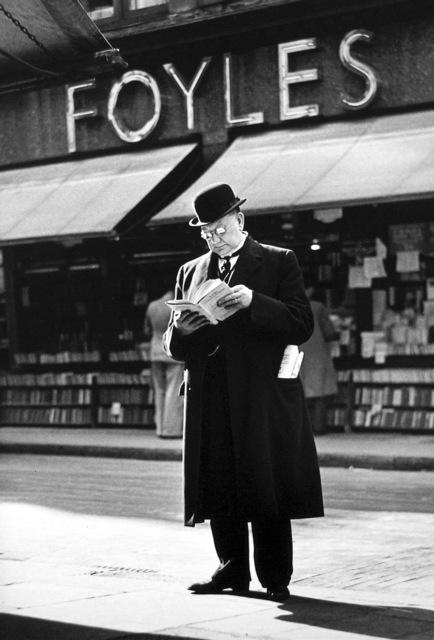 , 'London Charing Cross Road, [Man reading at Foyles],' 1936, Peter Fetterman Gallery