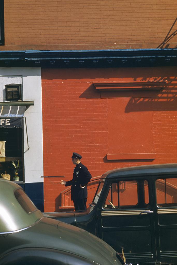 Werner Bischof – Policeman tossing nightstick, New York, USA, 1953