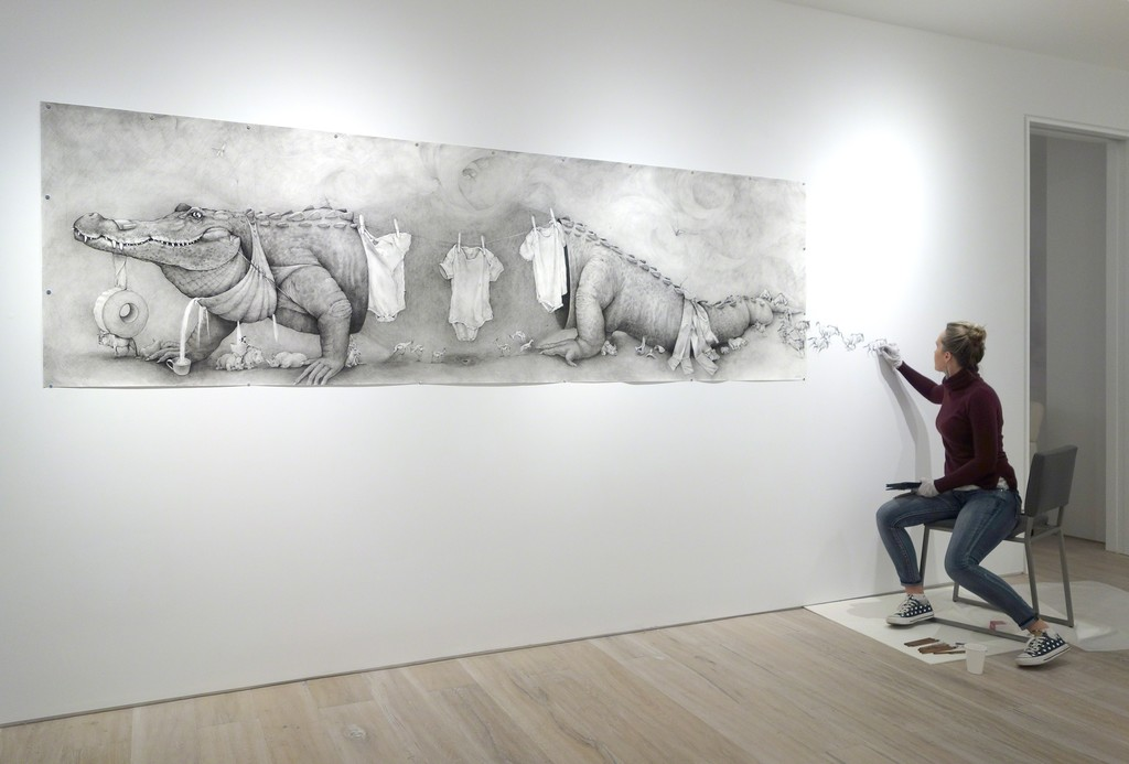 """Adonna Khare installing her work """"Alligator Clothesline"""" (2016)"""