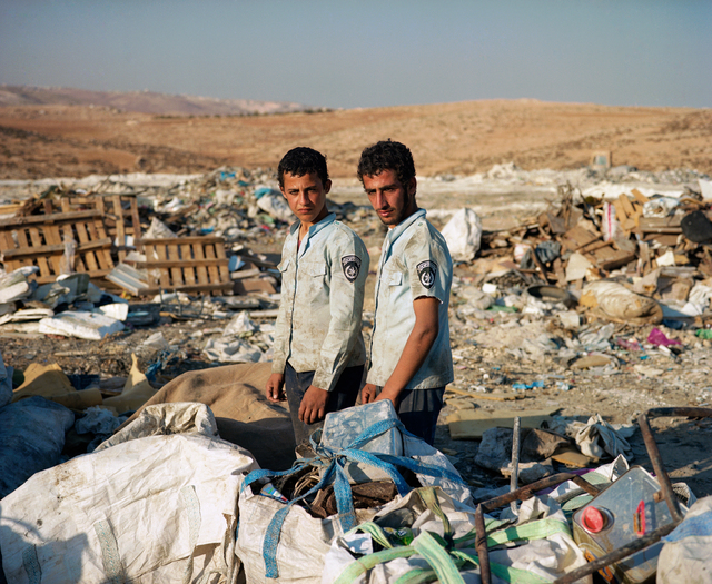 , 'Brothers Ahmed and Mahmoud of Yatta village, near Hebron, collect metal scraps at the nearby landfill in hopes to sell it for a small profit. They are wearing Israeli police shirts found in the trash. November, 2012 ,' 2012, Ronald Feldman Gallery